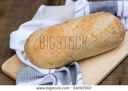 Loaf Of Sourdough Bread In Rustic Kitchend Setting