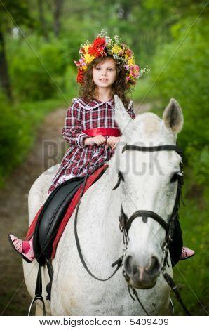 Cute Little Girl In Floral Wreath