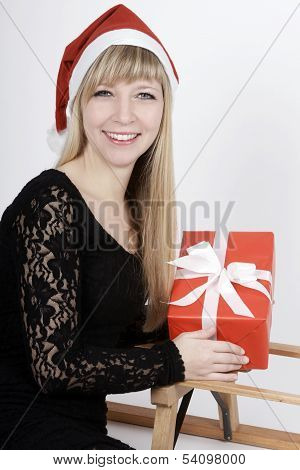 Woman With A Sleigh And A Gift