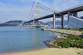 hong kong bridge, Tsing Ma Bridge and beach scenes in summer. poster