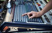 Sound engineer works with sound mixer hands close-up poster