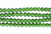 Strings of green glass beads isolated over white poster