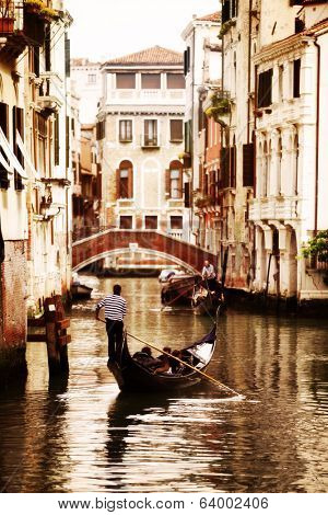 Gondola traveling down the canals of Venice in Italy