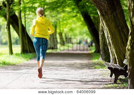 Woman Runner Running Jogging In Summer Park