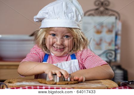 Cute Smiling Boy Baking Gingerbread