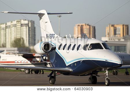 Raytheon 390 Premier 1A business aircraft running to the parking