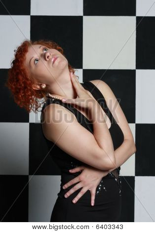 Redheaded Young Woman In Studio
