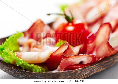 Bacon Stripes Served With Greens And Tomato. On White Background. Close Up View.