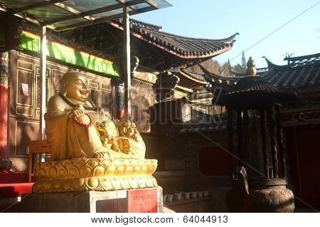 Outdoor Fat,smile Buddha In Temple ,lijiang  Dayan Old Town.
