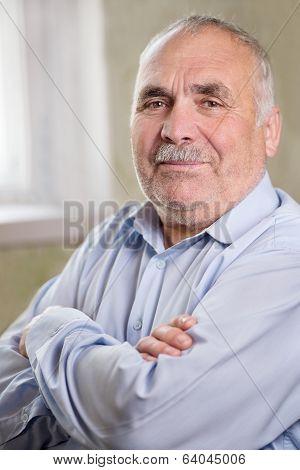 Portrait Of A Caucasian Senior Man With Mustache