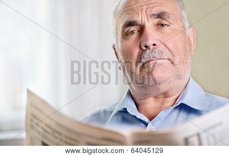 Senior Man Relaxing Reading A Newspaper