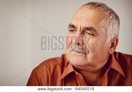 Thoughtful Senior Man Sitting Reminiscing