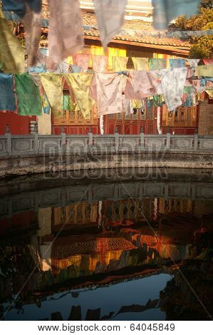 Tibetan Buddhist Prayer Flags On Pond In Chinese Temple ,lijiang Dayan Old Town.