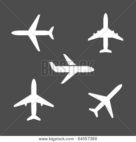 Five different airplane silhouette icons
