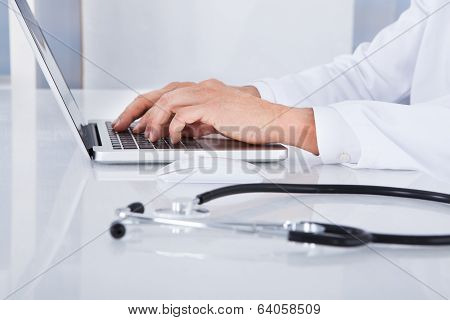 Close-up Of Doctor Using Laptop