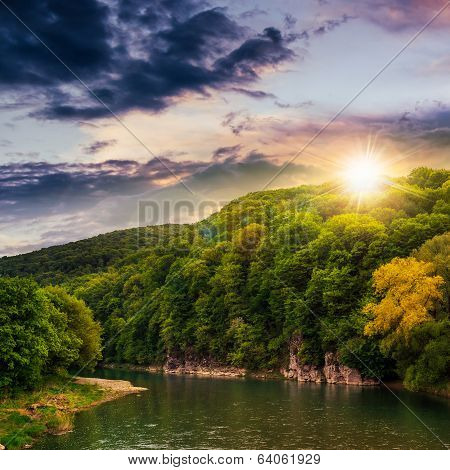Calm Mountain River On A Cloudy Summer Sunset