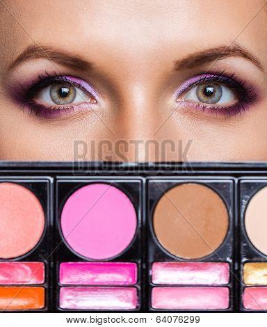 Closeup Of Beautiful Eyes With Makeup Kit And Glamorous Makeup