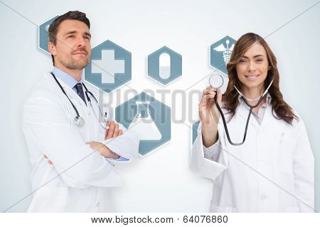 Composite image of medical team against blue medical interface with icons