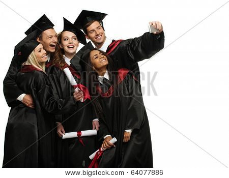 Multi ethnic group of graduated young students taking selfie