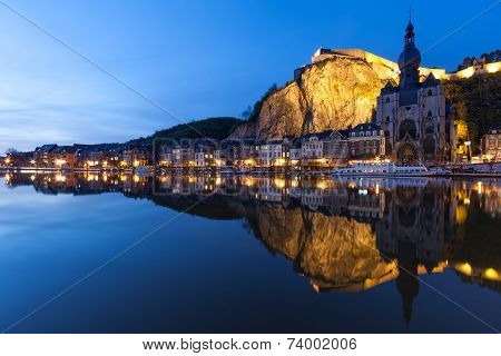 Cityscape of Dinant at night along the river Meuse Belgium poster