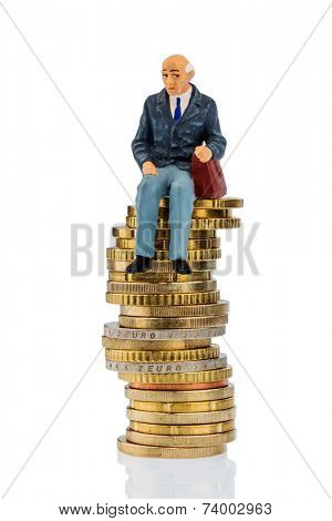 pensioners sitting on a pile of money, symbolic photo for pension, retirement, pension