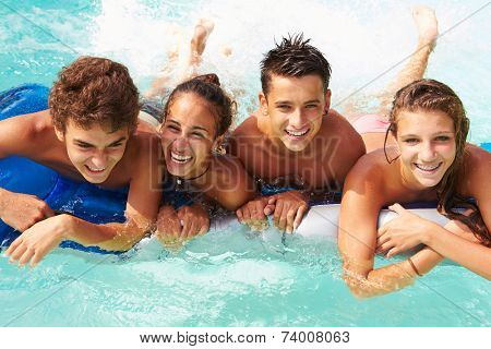 Group Of Teenage Friends Having Fun In Swimming Pool