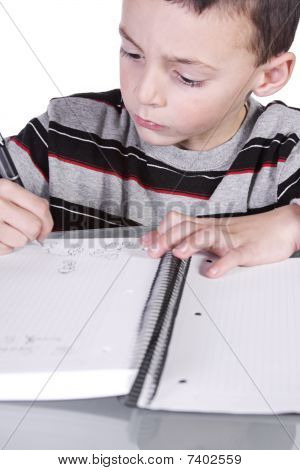 Little Cute Boy Practicing His Writing Skills