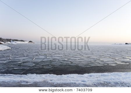 Seashore landscape in winter at sunset Hanko Finland. poster
