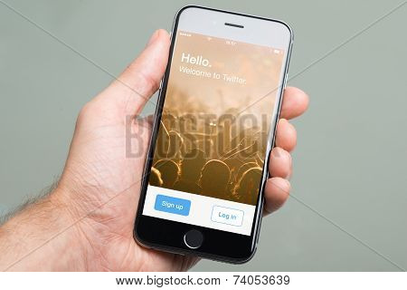 Hand Holding Apple Iphone6 With Twitter Home Screen