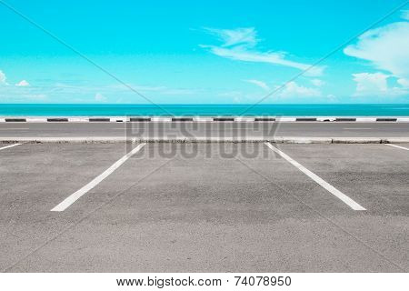 Empty parking area with sea landscape and blue sky poster