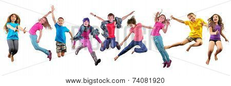 Happy Children Exercising And Jumping Over White