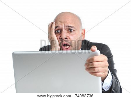 Hispanic Businessman In Stress At Laptop Holding Monitor Looking Desperate