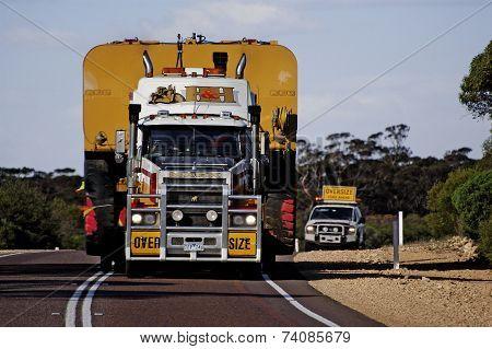 Pilot Car Following A Huge Australian Truck