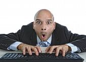 young businessman typing on computer keyboard with funny face expression on watching porn online and internet chat and social network addiction concept isolated on white background poster