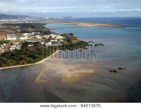 Honolulu International Airport And Coral Reef Runway Seen From The Air With Surrounding Water And Ho