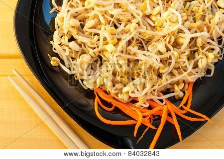 beansprouts salad on black plate, close-up