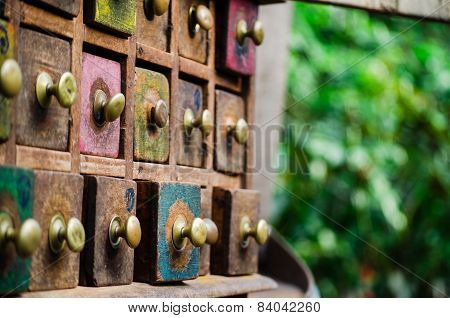 These beautiful antique spice drawers instill a feeling of curiosity and temptation. poster