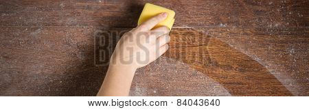 Close-up of soiled wooden parquet cleaning with dishrag poster