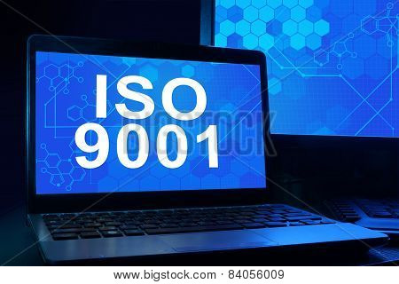 Computer with words iso 9001.