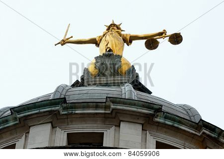 Looking up at justice statue old bailey poster
