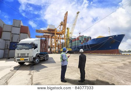 Foreman Control Industrial Container Cargo Freight Ship From His Manager With Working Crane Bridge I