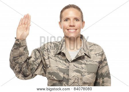 Female Airman With Hand Raised For Oath
