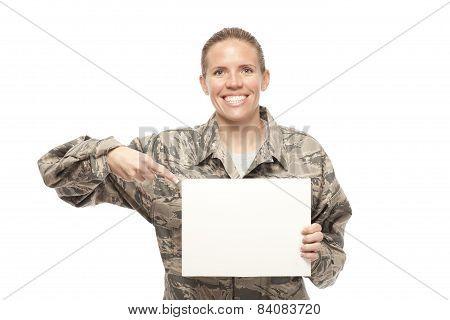 Female Airman Showing Placard