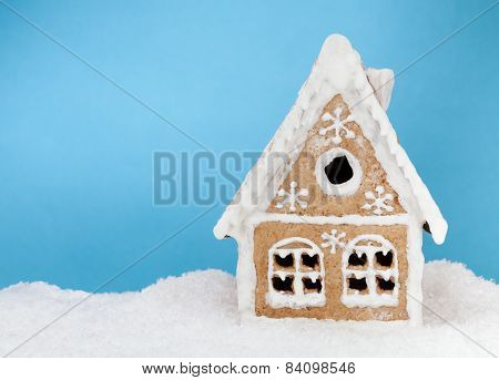 Homemade Gingerbread House On Blue Background