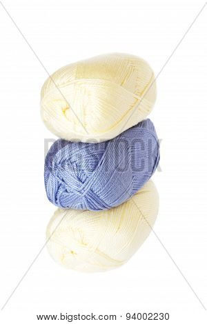 Light Blue And Cream Coloured Balls Of Acrylic Thread Isolated On White