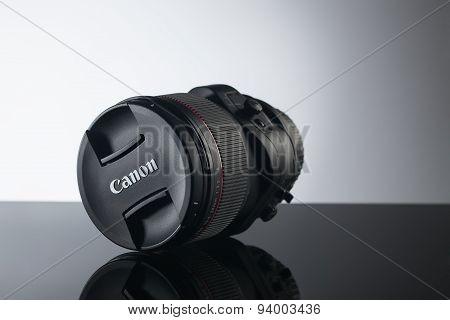 Photo lens close up on black background