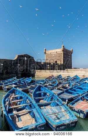 The Tower Of Essaouira With Blue Boats