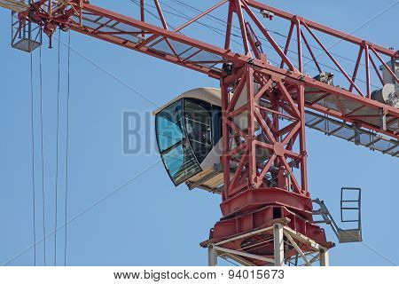 Crane Cab Against The Blue Sky
