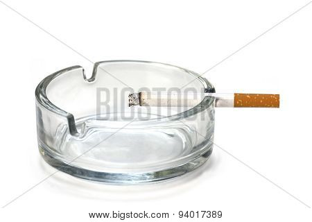 Filter Cigarette In An Ashtray, Isolated On White