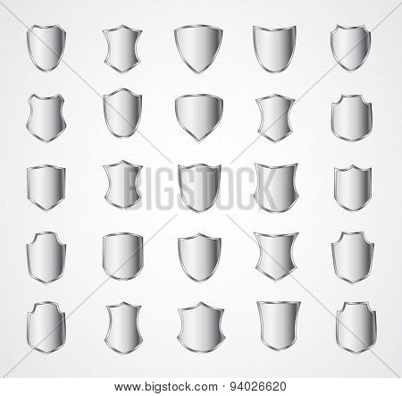Silver shield design set with various shapes.